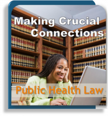 Smiling woman sitting in a law library in front of laptop
