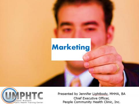 """Businessman holding up a small card in front of his face that says """"Marketing"""""""